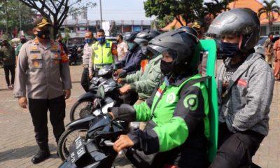 Ojol dan Ojek Pangkalan Terima Bantuan Polres Malang